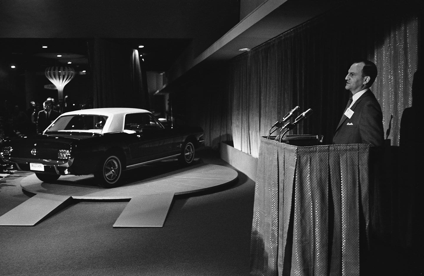 Lee Iacocca introduces the new 1965 Ford Mustang to the media in the Ford Pavilion at the 1964 World's Fair in New York