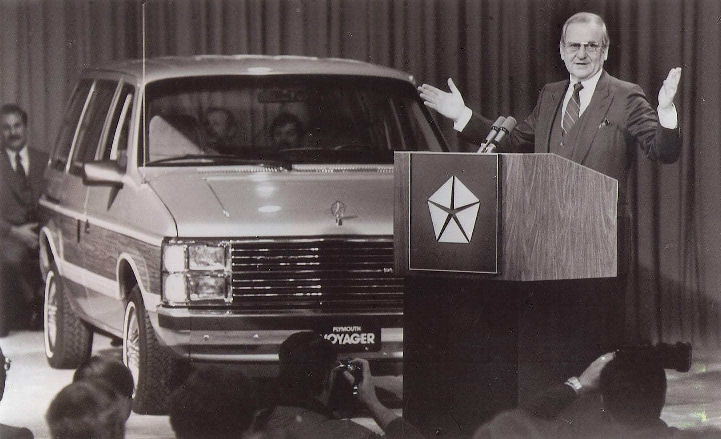 Lee Iacocca, then chairman of Chrysler Corporation, introduced the company's new breed of garageable 1984 front-wheel-drive family wagons and vans, the Plymouth Voyager, Dodge Caravan and Dodge Mini Ram Van