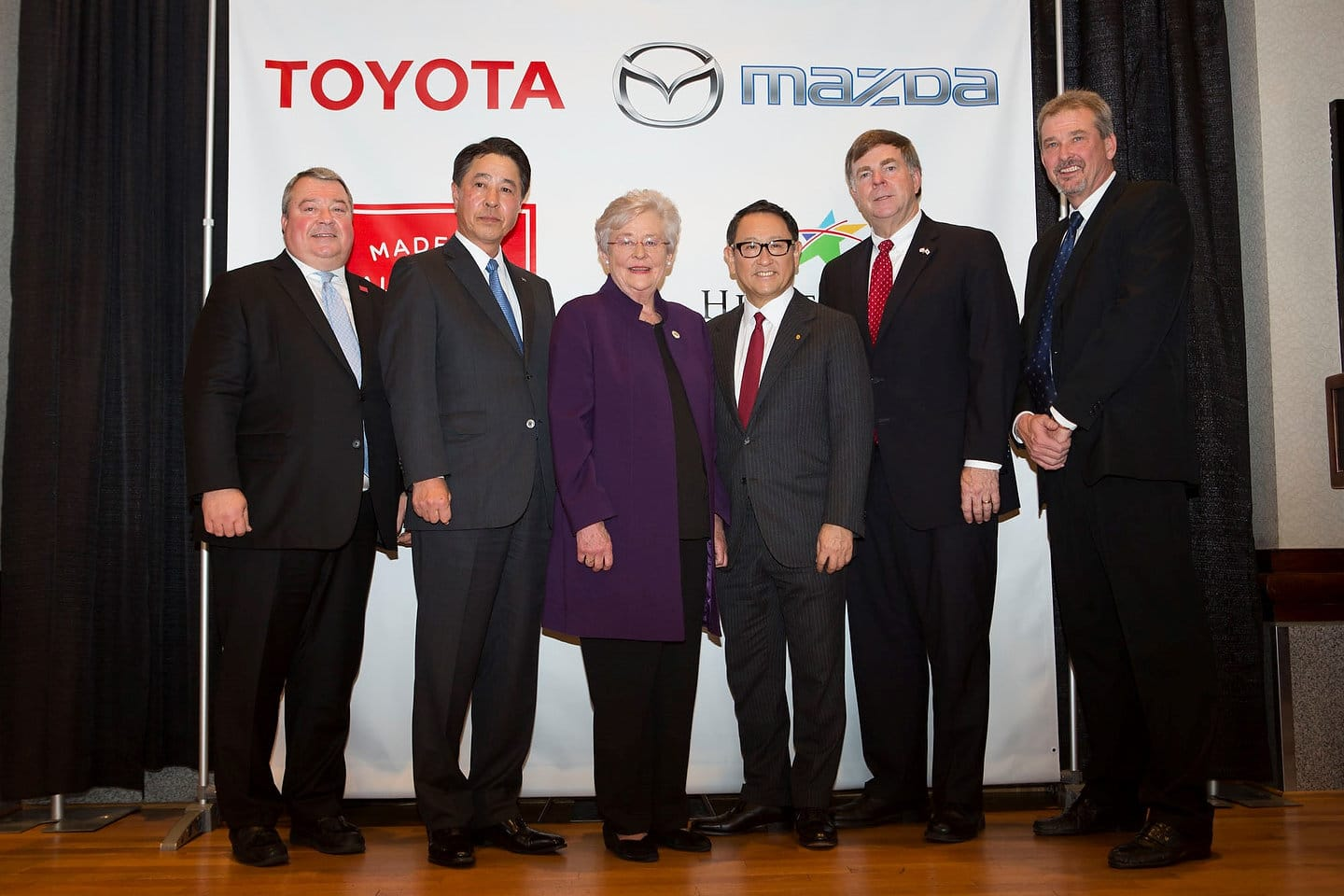 Left to right: Secretary Greg Canfield, Mazda Motor Corporation President and Chief Executive Officer Masamichi Kogai, Alabama Govornor Kay Ivey, Toyota Motor Corporation President Akio Toyoda, Huntsville Mayor Tommy Battle, Commission Chairman Mark Yarbrough