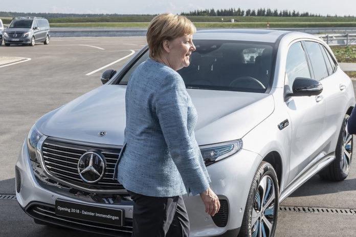 German Chancellor Angela Merkel with the Mercedes-Benz EQC 400 4MATIC